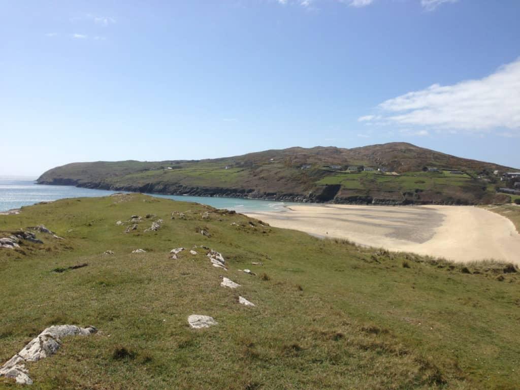 Photo of an Irish beach with find, golden sand