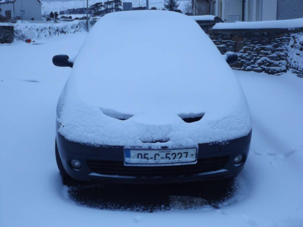 Car covered in snow in County Cork