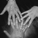 The hands of 3 women, each wearing a Claddagh Ring