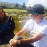 An Irish man and an American woman sitting on a hill
