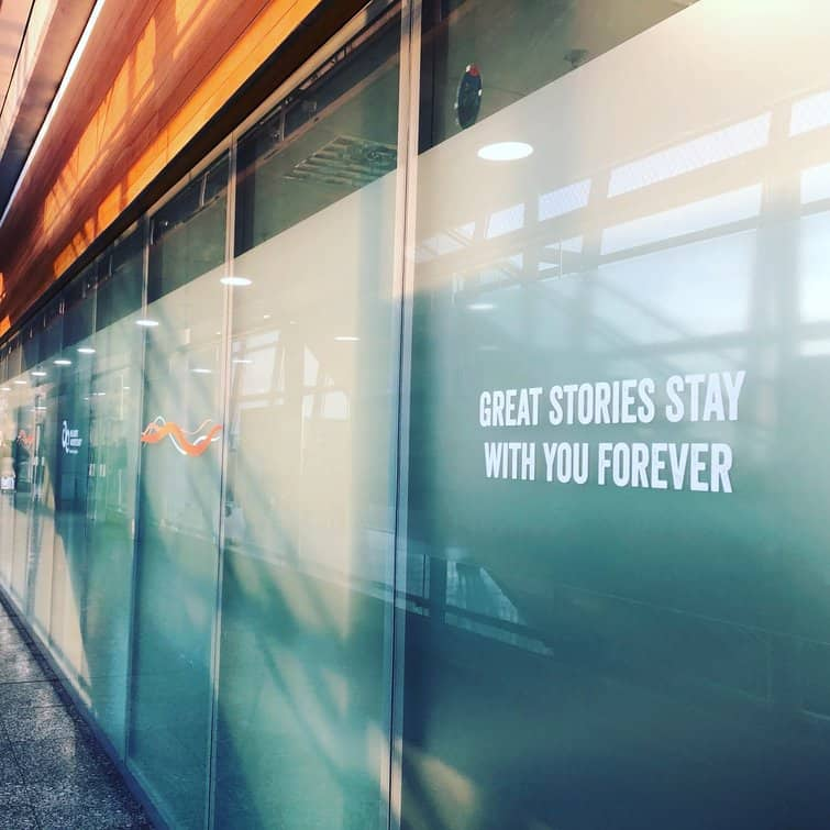 "The welcome wall at Cork Airport reads ""Great Stories Stay with you Forever"""